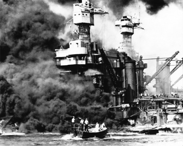 This photo of the battleships West Virginia and Tennessee was taken while rescue operations were still underway.  The Tennessee escaped major damage and was back in action by early 1942.  The badly damaged West Virginia was rebuilt and rejoined the Fleet in time to participate in some of the last major battles of the Pacific war.