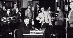 Photo of first broadcast, 1941: Mr. Godfrey is center foreground, the band and singers are in the background. The lead singer, Patty Clayton, is at right.