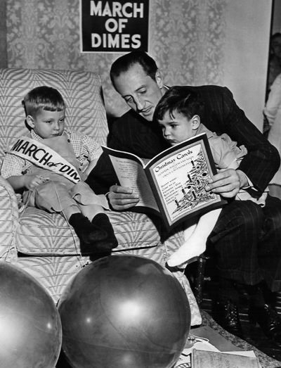 Basil Rathbone reading to children with infantile paralysis