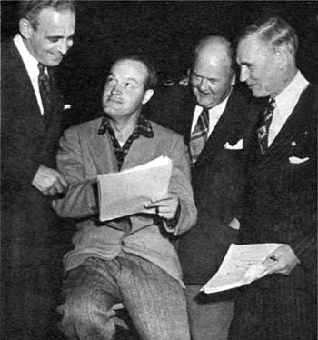 Producer Paul Stewart, Bob Hope, Homer Fickett, Walter Huston look over a script on Cavalcade of America