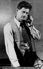 Norman Corwin on the telephone.