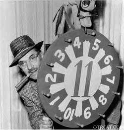Groucho Marx hides behind the famous wheel