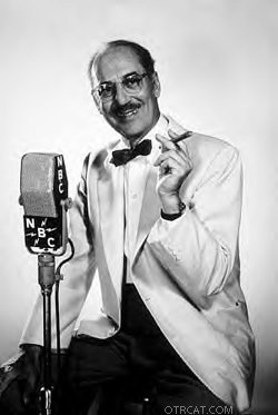 Groucho Marx with signature cigar at microphone