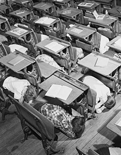 Children hiding under desks