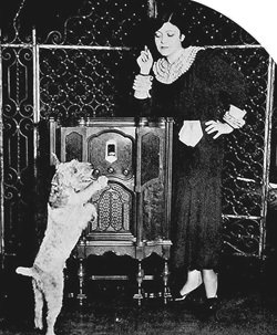 "Rosa Ponselle, prima donna of the Metropolitan Opera Company, and her dog, ""Whisker.""  One of the many artist who, through their alluring offering via the big chains, are making the ownership of a good receiving set ever more desirable."