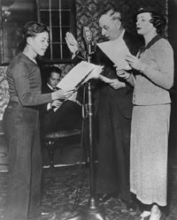 Billy Idleson, Art Van Harvey and Bernadine Flynn at the broadcasting microphone