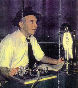 Walter Winchell at microphone