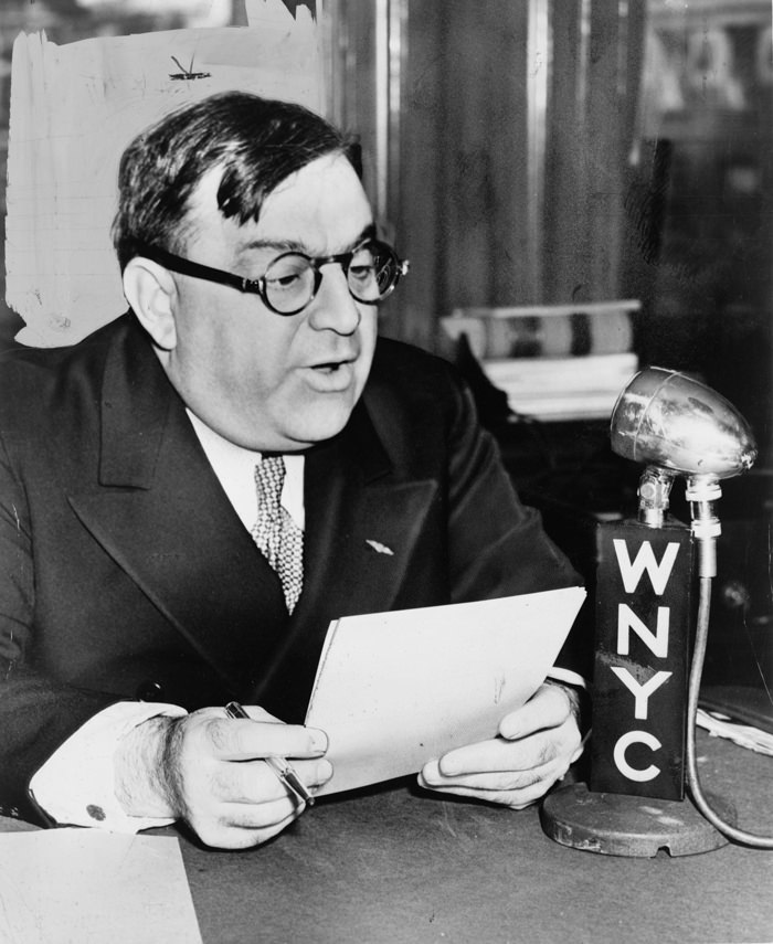 Fiorello LaGuardia reading comics on the radio
