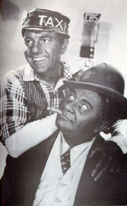 Gosden and Correll, blackface in this publicity photo, were the voices behind Sam and Henry Old Time Radio Show