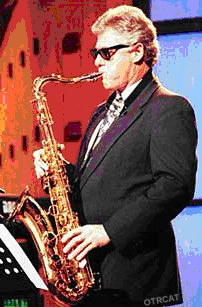 Clinton playing the saxophone