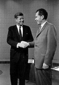 Kennedy shaking Nixon's hand