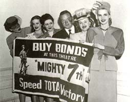 BUY BONDS AT THIS THEATER; Mighty 7th Speed TOTAL VICTORY sign.