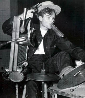 Spike Jones playing a multitude of instruments