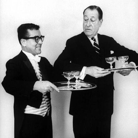 Arthur Treacher demonstrating how to serve drinks