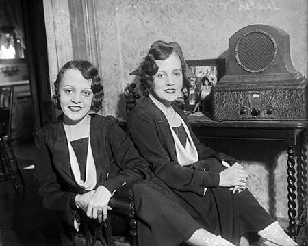Twins Listening to Radio