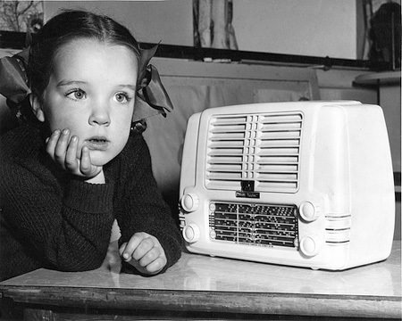 Your Story Parade: Child listening to radio