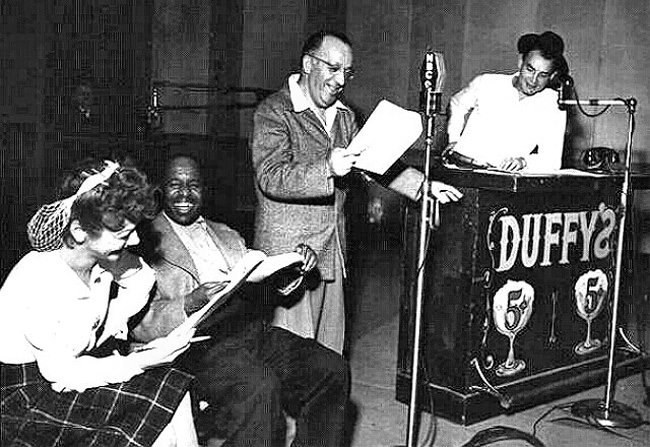 "Duffy's Tavern Cast: Cast of radio's ""Duffy's Tavern."" Pictured from left to right: Sandra Gould (""Miss Duffy""), Eddie Green (""Eddie the Waiter""), Charles Carton (""Finnegan""), Ed Gardener (""Archie"")."